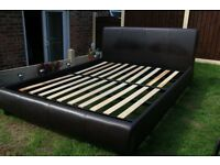 For sale Brown leather King size bed frame.