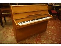 Modern teak upright piano. Excellent condition. Tuned and delivery available uk wide
