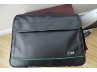 Leather laptop carrying case.