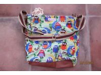 Brand new with tag. Owl Bag, with adjustable strap. Lined. Decent size. Has zip & internal zip & po
