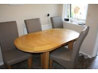 Solid Oak dining table and 4 high back leather chairs