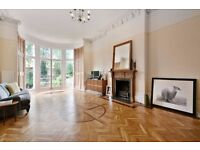 stunning raise ground floor 3 bedroom garden flat, spacious reception room, close to tube and shops