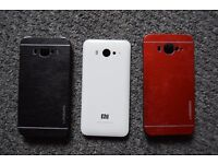 Xiaomi Mi2S original case (white). Including two spare cases (black and red).
