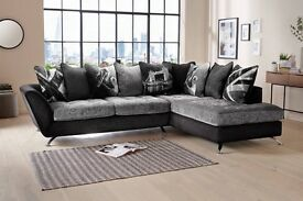 Black grey corner sofa with chair and footstool
