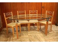 Housing Units - The Domas Collection - Glass Top Oval Table with 4 Chairs