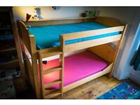 Beautiful Wooden Bunk Bed. Great quality and very solid. Guard Rail and ladder
