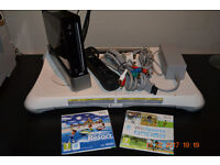 Nintendo Wii Console + Controller + Wii Fit Board