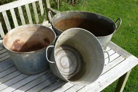 Set of galvanised baths; ideal for outdoor planters.