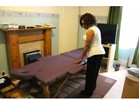 Professional masseuse offers deep tissue massage