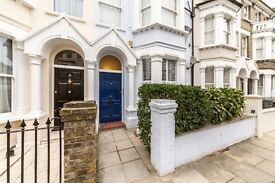 Completely refurbished two double bedroom flat with a private paved garden in Fulham Broadway.