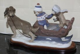 LARGE LLADRO RETIRED FIGURINE 5037. CHILDREN ON SLEIGH PULLED BY A DOG.