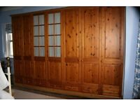 Fitted Wardrobes - 7 Pine Doors with variety of shelves, rails & draws would suit DIY enthusiast