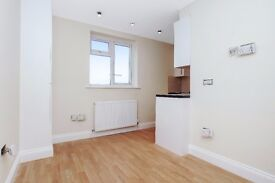 Two bedroom apartment newly converted with timber style flooring, decorated in neutral colours
