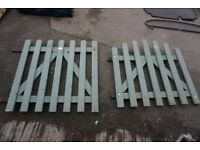 Two painted timber garden gates