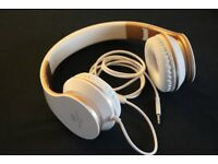 A white and gold colour headphone