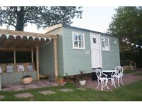 Romantic en-suite accommodation for 2 in a luxury shepherd's hut with stunning views.