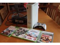 Xbox 360 - with wireless controller and 4 games.