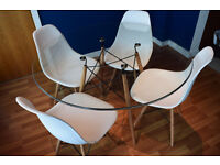 Designer round glass Eiffel dinning table with beech legs almost brand new to match Eames chair