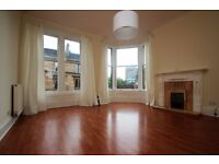 Stunning two bed corner property with open aspect lounge looking down Byres Road.