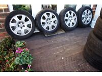 4x GENUINE AUDI ALLOYS FROM A2 R15 5X100 VERY GOOD CONDITION would fit VW AUDI SEAT SKODA