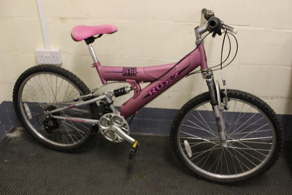 """Raleigh Roxz 24.DS Mountain Bike (C188in Stoke on Trent, StaffordshireGumtree - """"In full working order and good condition. Full serviced and safety checked"""" Type Mountain Bike Brand Raleigh Model 24.DS Gender Female Colour Pink Wheel 26"""" Frame 14.5"""" Gears 18 Suspension Front and rear If youre interested in the bike, please..."""