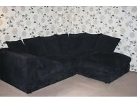 Black corner sofa - soft black thick corduroy type material. Very good condition.