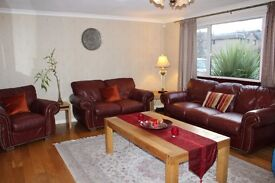 MUST GO: Reid brown leather Sofa set