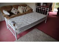 White single metal bed with mattress hardly used.