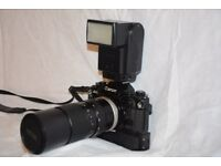 Canon A1 35mm SLR film camera + Lense + Flash – recently serviced locally. Gurantee till May 2017