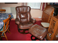 Brown leather swivel chair and footrest.