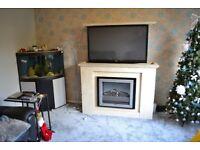 Marble fire surround, Unique TV cabinet, and cream fire surround.