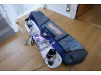 Snowboard, boots, bindings and carrying bag