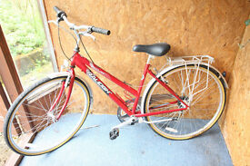 ladies raleigh Pioneer 120 bicycle in red. Used but in good condition