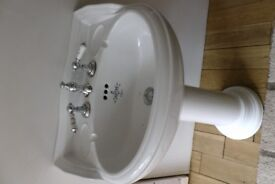 Barthroom basin and pedestal incudes taps and waste