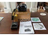 Nikon D5200 camera body, 24.1 megapixels.