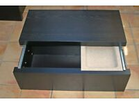 An IKEA black slide top storage cheast with tray in excellent condition