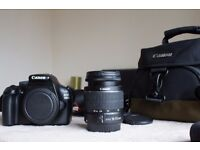 Canon DSLR 1100d with 18-55mm lens with carry bag, spare battery and lens hood.