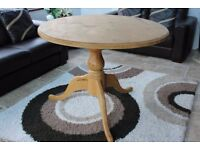 Circular solid pine waxed dining table