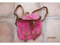 Dark pink polka dot canvas with leather trim/straps rucksack.