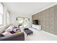 A unique and contemporary two bedroom, two bathroom house with an enclosed courtyard in Holland Park