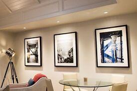 Trio of black and white framed photographs