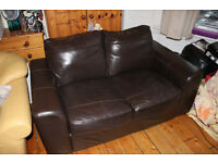 Dark Brown Two-seater Leather Sofa. In good condition and Ready for Collection.