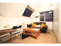 TOP FLOOR STUDIO FLAT NEXT TO TUBE EALING BROADWAY- INCLUDING GAS AND WATER BILLS- GARDEN & PARKING