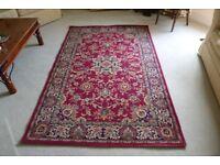 Patterned burgundy rug