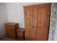 Pine wardrobe, chest of drawers and bedside table set