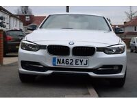 Pearl white BMW 320d Sport edition