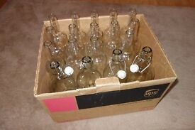 15 clear wine bottles and 4 x 1 Litre stopper bottles