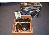 sega mega driver console + sonic games, +2 controllers .