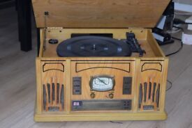 WOODEN RECORD PLAYER/CD/RADIO WITH ANTENNA CAN BE SEEN WORKING