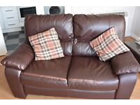 Top quality, 2 seat leather couch and care kit.